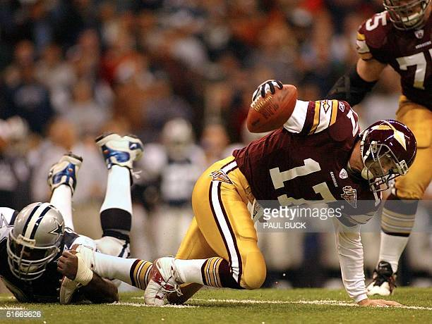 Dallas Cowboys' defensive lineman La'Roi Glover drops Washington Redskin quarterback Danny Wuerffel for a loss effectively killing the Redskins'...