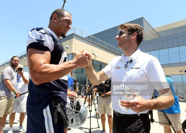 Dallas Cowboys defensive lineman Tyrone Crawford meets Indianapolis 500 Champion Will Power after practice at The Ford Center at The Star on May 30...