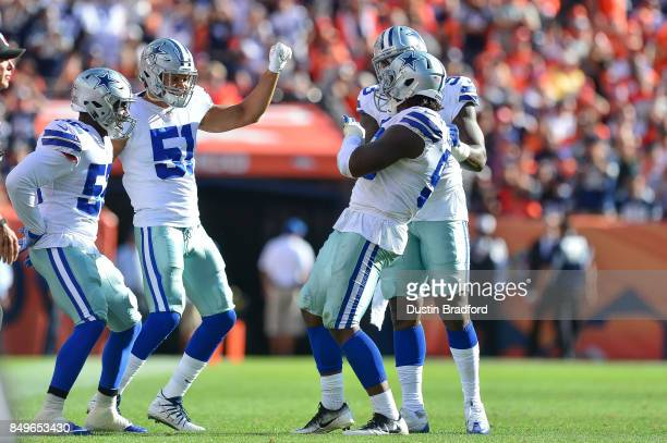 Dallas Cowboys defensive players, including Justin Durant, Kyle Wilber, and Benson Mayowa celebrate after a play against the Denver Broncos at Sports...