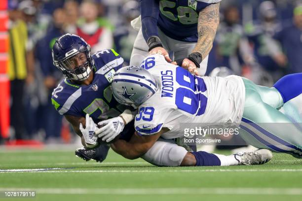 Dallas Cowboys defensive tackle Antwaun Woods hits Seattle Seahawks running back Chris Carson behind the line of scrimmage during the NFC wildcard...