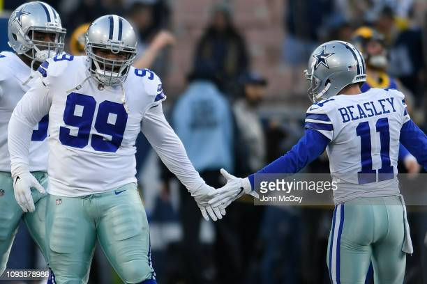ab6efc21e Dallas Cowboys defensive tackle Antwaun Woods shakes hands with wide  receiver Cole Beasley before playing the. Dallas Cowboys v Los Angeles Rams