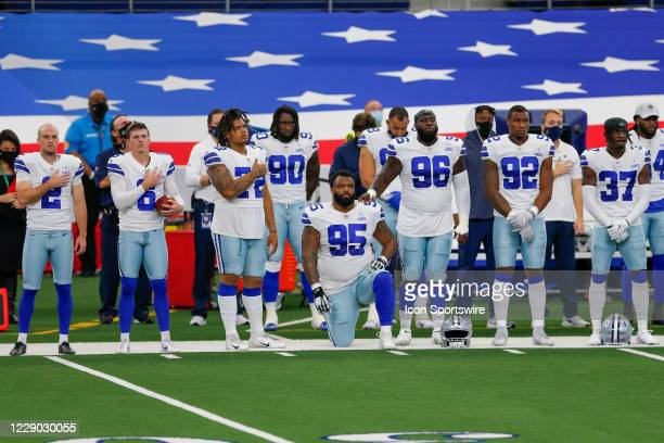 Dallas Cowboys Defensive Tackle Dontari Poe is the only Dallas player to kneel prior to the NFL game between the New York Giants and Dallas Cowboys...