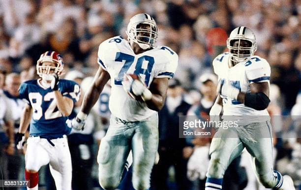 Dallas Cowboys defensive tackle Leon Lett runs back a fumble recovery only to have Buffalo Bills wide receiver Don Beebe strip the ball away at the...