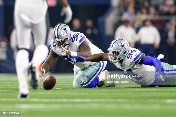 Dallas Cowboys Defensive Tackle Maliek Collins and Defensive End Randy Gregory scramble to recover a fumble during the game between the Philadelphia...