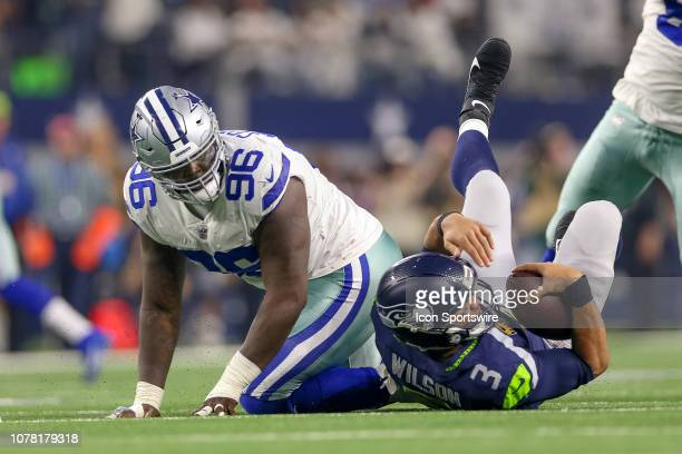 Dallas Cowboys defensive tackle Maliek Collins sacks Seattle Seahawks quarterback Russell Wilson during the NFC wildcard playoff game between the...