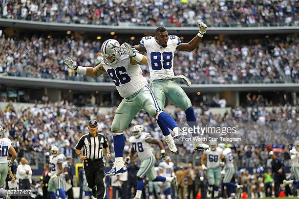 Dallas Cowboys defensive tackle Nick Hayden celebrates with teammate Dez Bryant after Hayden recovered a Minnesota Vikings fumble in the end zone for...