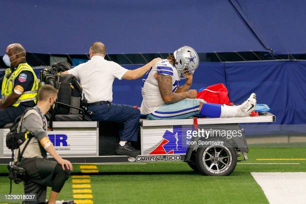 Dallas Cowboys Defensive Tackle Trysten Hill is carted off the field after suffering an injury during the NFL game between the New York Giants and...