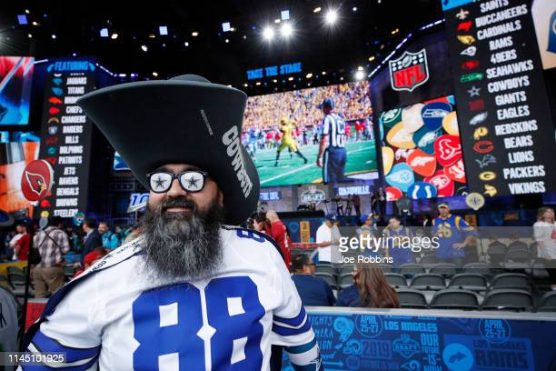 Dallas Cowboys fan looks on prior to the start of the first round of the NFL Draft on April 25 2019 in Nashville Tennessee