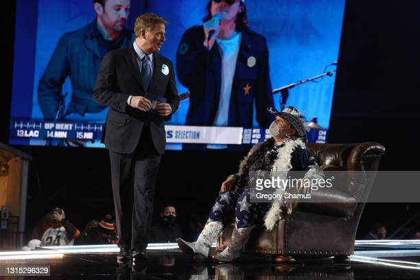Dallas Cowboys fan speaks with NFL Commissioner Roger Goodell onstage during round one of the 2021 NFL Draft at the Great Lakes Science Center on...