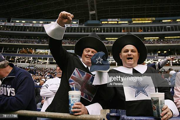 Dallas Cowboys fans celebrate a touchdown at the Thanksgiving Game between the New York Jets and the Dallas Cowboys at Texas Stadium Irving Texas on...