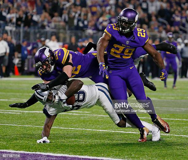 Dallas Cowboys free safety Byron Jones and cornerback Brandon Carr gang up to stop Minnesota Vikings wide receiver Cordarrelle Patterson for a loss...
