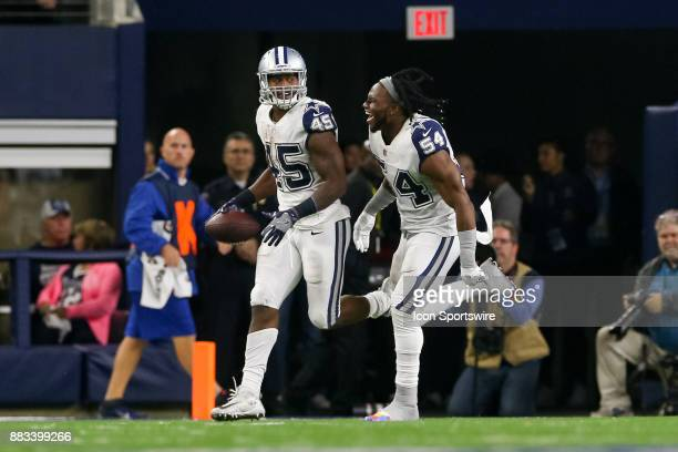 Dallas Cowboys fullback Rod Smith celebrates his touchdown with his brother linebacker Jaylon Smith during the Thursday Night Football game between...