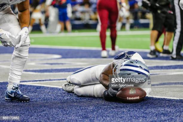 Dallas Cowboys fullback Rod Smith puts the football to bed after scoring a touchdown during the game between the Dallas Cowboys and the Washington...