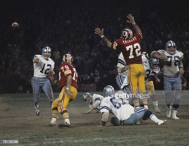 Dallas Cowboys Hall of Fame quarterback Roger Staubach throws a pass in a 2821 loss to the Washington Redskins on November 17 1974 at RFK Stadium in...