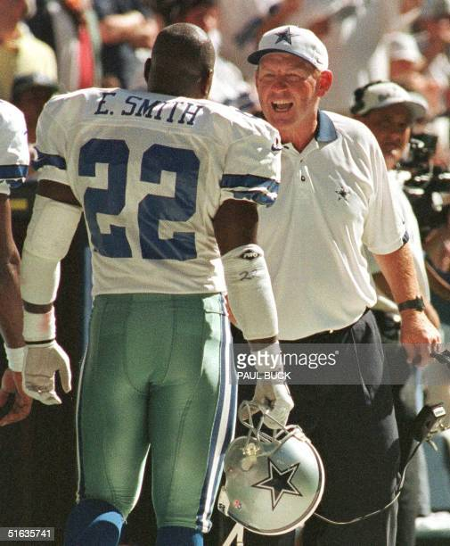 Dallas Cowboys head coach Chan Gailey congratulates running back Emmitt Smith following the Cowboys' first touchdown of the game with the Arizona...
