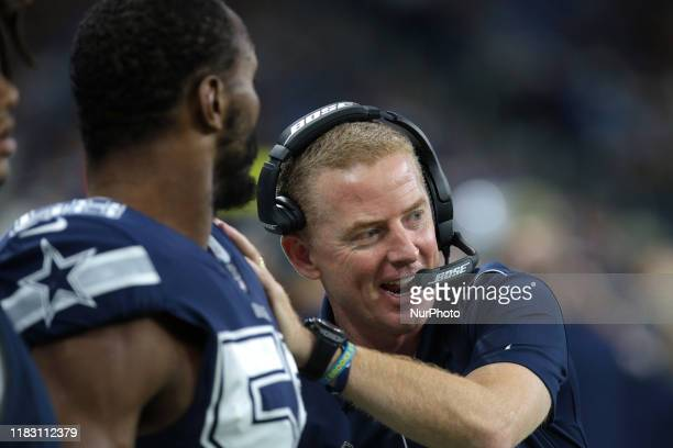 Dallas Cowboys head coach Jason Garrett celebrates with defensive end Robert Quinn after a touchdow during the first half of an NFL football game...