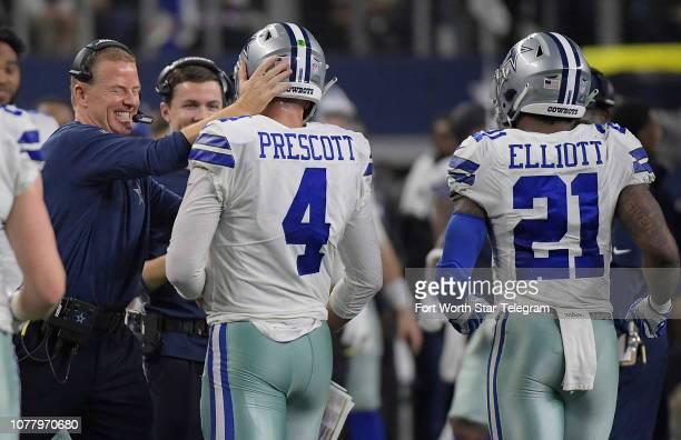 Dallas Cowboys head coach Jason Garrett celebrates with quarterback Dak Prescott after his fourthquarter touchdown run against the Seattle Seahawks...