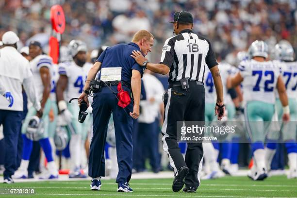 Dallas Cowboys Head Coach Jason Garrett gets an explanation of a call from line judge Byron Boston during the game between the New York Giants and...