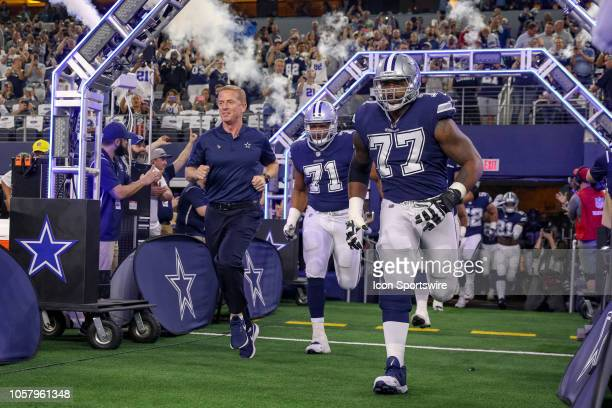 Dallas Cowboys head coach Jason Garrett offensive tackle La'el Collins and offensive tackle Tyron Smith lead the team out of the tunnel prior to the...