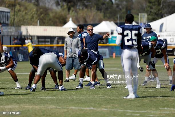 Dallas Cowboys Head Coach Jason Garrett runs the players through drills during training camp at River Ridge Playing Fields on August 4 2018 in Oxnard...