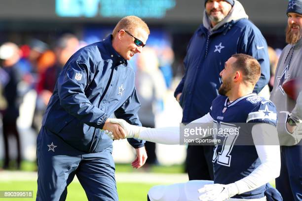 Dallas Cowboys head coach Jason Garrett shakes hands with Dallas Cowboys tight end Geoff Swaim on the field prior to the National Football League...