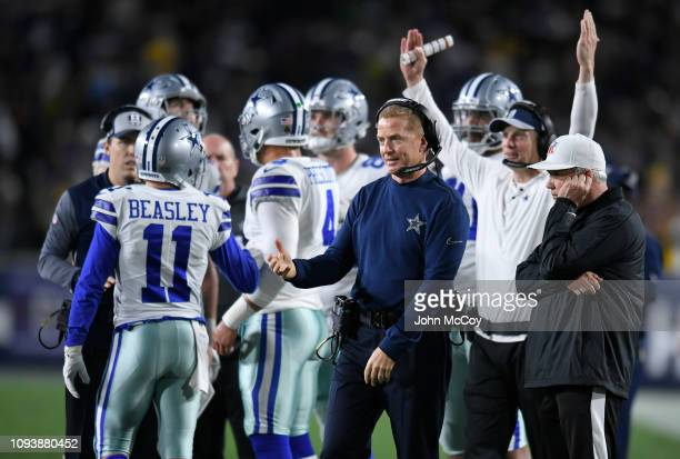 Dallas Cowboys head coach Jason Garrett talks to wide receiver Cole Beasley in the fourth quarter against the Los Angeles Rams at Los Angeles...