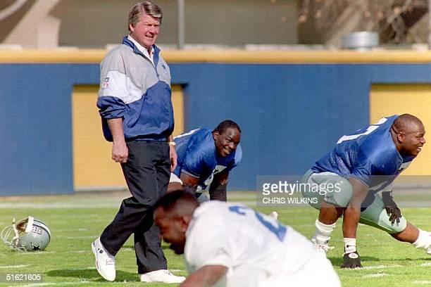 Dallas Cowboys head coach Jimmy Johnson walks the field as his team stretches for workouts 28 January 1993 in preparation for Super Bowl XXVII The...