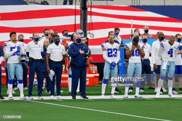 Dallas Cowboys Head Coach Mike McCarthy stands for the National Anthem prior to the NFL game between the New York Giants and Dallas Cowboys on...