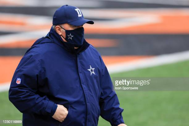 Dallas Cowboys head coach Mike McCarthy walks onto the field before the game against the Dallas Cowboys and the Cincinnati Bengals on December 13 at...