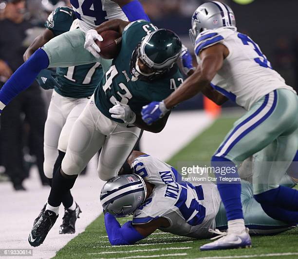 Dallas Cowboys inside linebacker Damien Wilson and free safety Byron Jones tackle Philadelphia Eagles running back Darren Sproles in the first...
