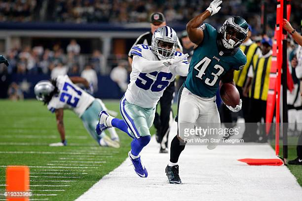 Dallas Cowboys inside linebacker Damien Wilson chases Philadelphia Eagles running back Darren Sproles out of bounds during the first half on Sunday...