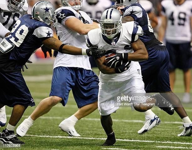 Dallas Cowboys Julius Jones caries the ball during drills at training camp in San Antonio Texas Sunday August 5 2007