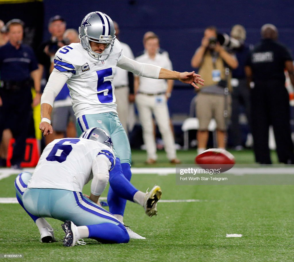 181683e09 Dallas Cowboys. Dallas Cowboys kicker Dan Bailey (5) kicks out of the hold  of punter Chris Jones ...