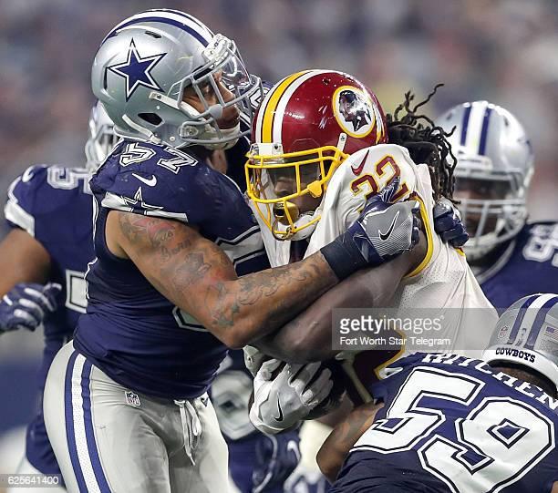 Dallas Cowboys linebacker Damien Wilson stuffs Washington Redskins running back Robert Kelley during the second half on Thursday Nov 24 2016 at ATT...
