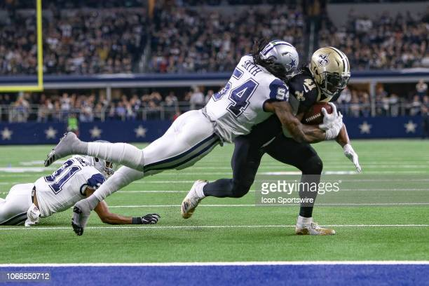 Dallas Cowboys Linebacker Jaylon Smith stops New Orleans Saints Running Back Alvin Kamara just short of the goal line during the game between the...