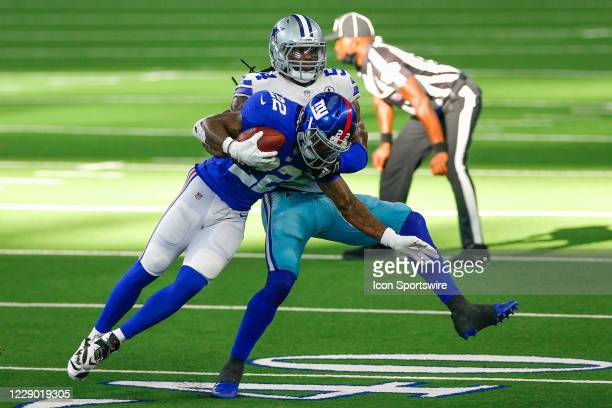 Dallas Cowboys Linebacker Jaylon Smith tackles New York Giants Running Back Wayne Gallman during the NFL game between the New York Giants and Dallas...