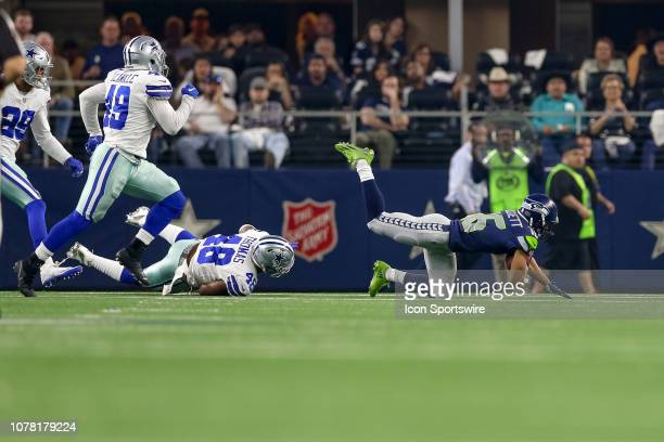 Dallas Cowboys linebacker Joe Thomas trips up Seattle Seahawks wide receiver Tyler Lockett during the NFC wildcard playoff game between the Seattle...