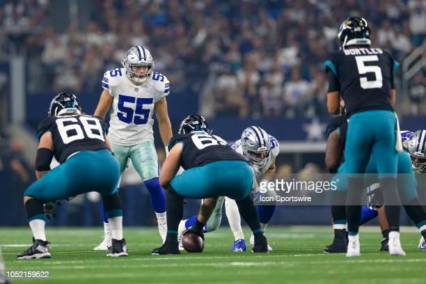 Dallas Cowboys linebacker Leighton Vander Esch peers over the line of scrimmage at Jacksonville Jaguars quarterback Blake Bortles during the game...