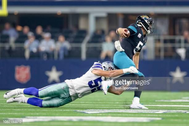 Dallas Cowboys linebacker Leighton Vander Esch tackles Jacksonville Jaguars quarterback Blake Bortles during the game between the Jacksonville...