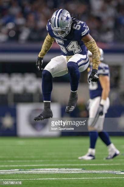 Dallas Cowboys middle linebacker Jaylon Smith leaps in protest after he is called for pass interference during the game between the Tennessee Titans...