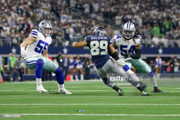Dallas Cowboys middle linebackers Jaylon Smith and Leighton Vander Esch pursue Seattle Seahawks wide receiver Doug Baldwin during the NFC wildcard...