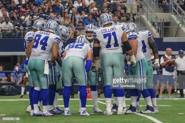 Dallas Cowboys offense huddles during the game between the Dallas Cowboys and the Los Angeles Rams on October 1 2017 at ATT Stadium in Arlington TX