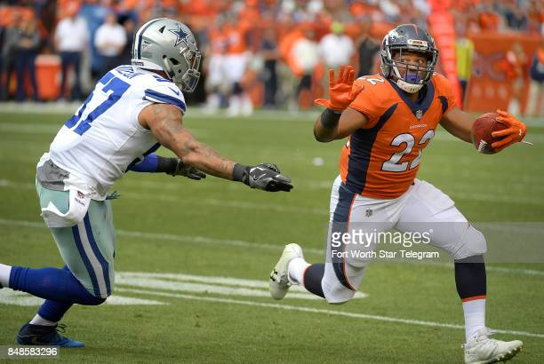 Dallas Cowboys outside linebacker Damien Wilson can't bring down Denver Broncos running back CJ Anderson during the first quarter on Sunday Sept 17...
