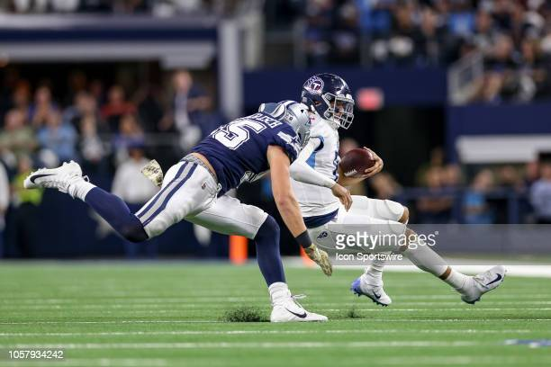 Dallas Cowboys outside linebacker Leighton Vander Esch is called for a personal foul while tackling Tennessee Titans quarterback Marcus Mariota...