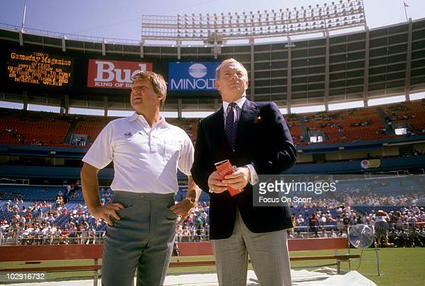 CIRCA 1990 Dallas Cowboys Owner Jerry Jones and Head Coach Jimmy Johnson in this portrait on the field circa 1990 before an NFL football game Jones...