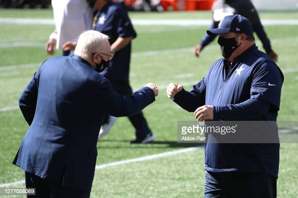 Dallas Cowboys Owner Jerry Jones and head coach Mike McCarthy fist bump before their game against the Seattle Seahawks at CenturyLink Field on...