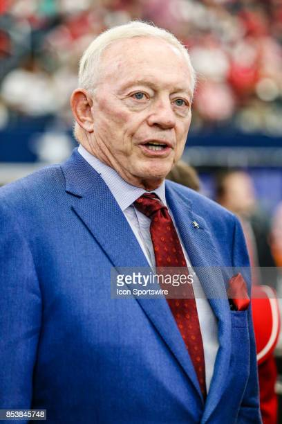Dallas Cowboys owner Jerry Jones gets a Arkansas Razorbacks Jersey for the 1961 Arkansas National Championship team during the game between the...