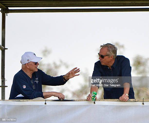 Dallas Cowboys owner Jerry Jones has a conversation with public relations director Rich Dalrymple during the Blue vs White scrimmage on Sunday Aug 7...