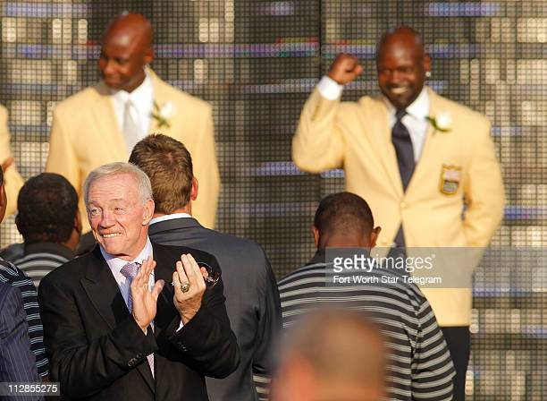 Dallas Cowboys owner Jerry Jones looks around as Emmitt Smith gets an enthusiastic welcome during the Enshrinement Ceremony for the Pro Football Hall...