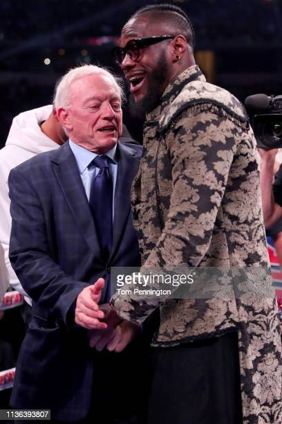 Dallas Cowboys owner Jerry Jones talks with boxer Deontay Wilder before Errol Spence Jr takes on Mikey Garcia in an IBF World Welterweight...